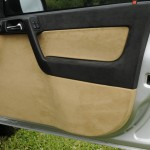 Precision custom door card finished in genuine alcantara